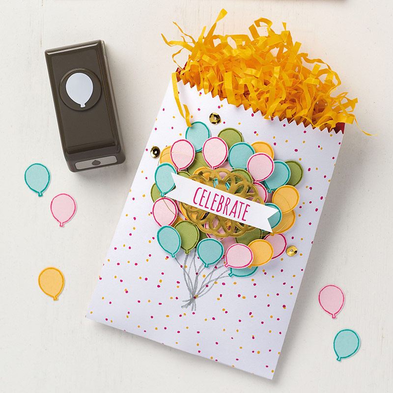 Treat bag decorated with balloons punched by the Party Punch Pack