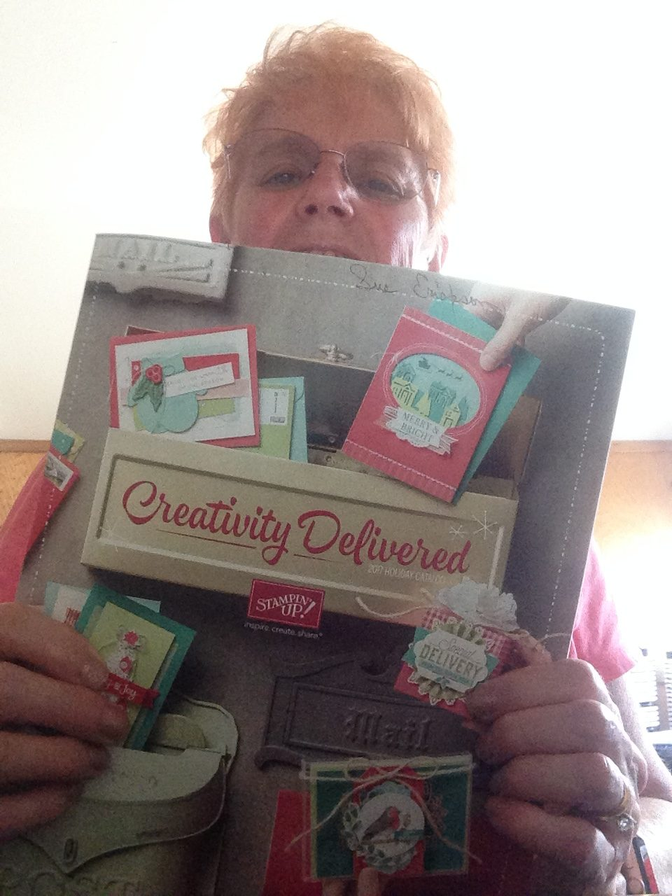 Sue holding the holiday catalog